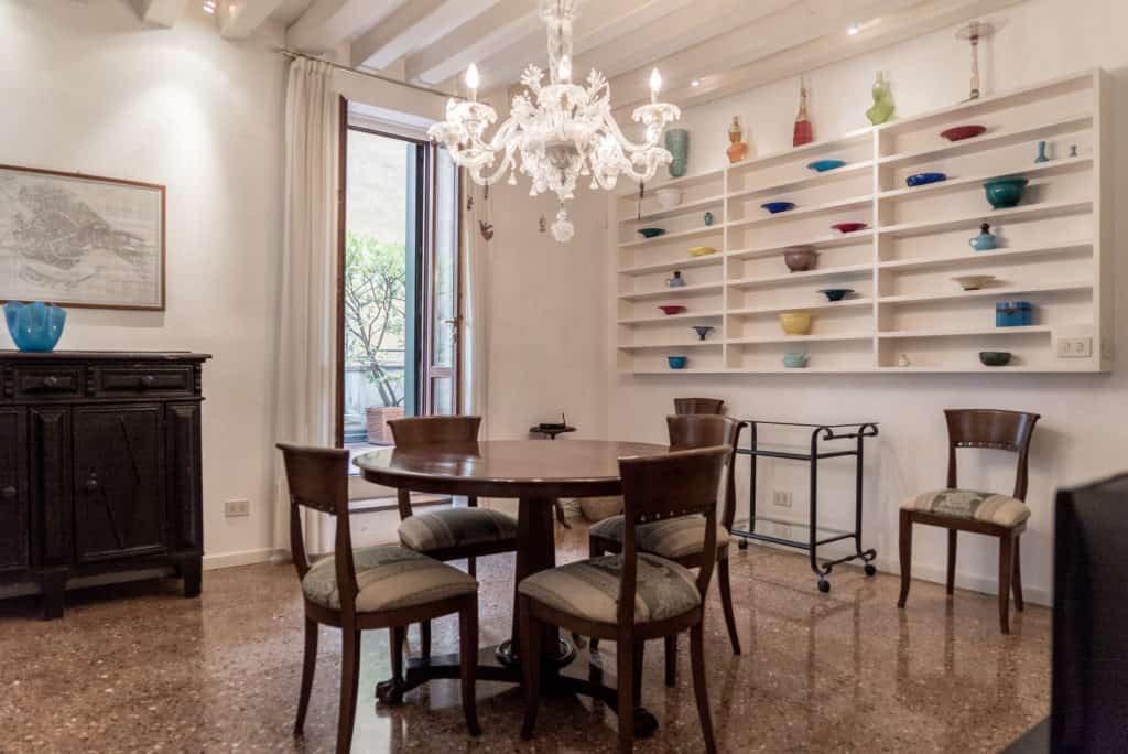 Left side of spacious dining room with ancient Venetian chandelier - Accademia Terrazza Apartment