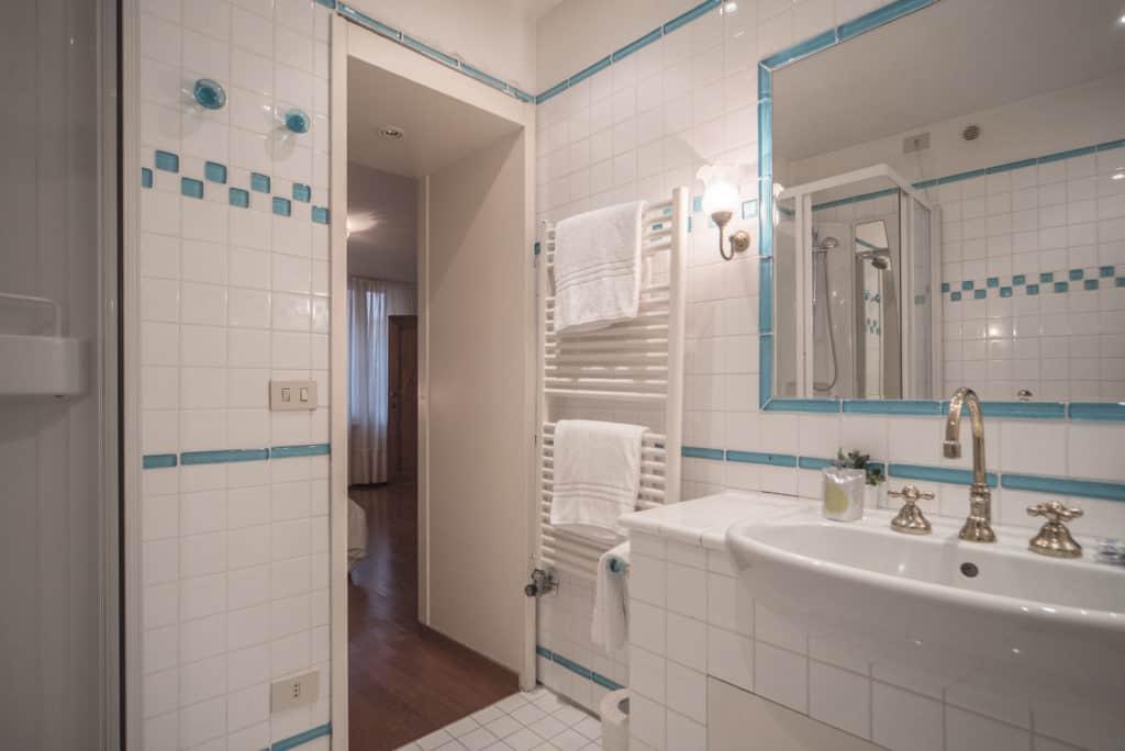 Exit of large white bathroom - Accademia Terrazza Apartment