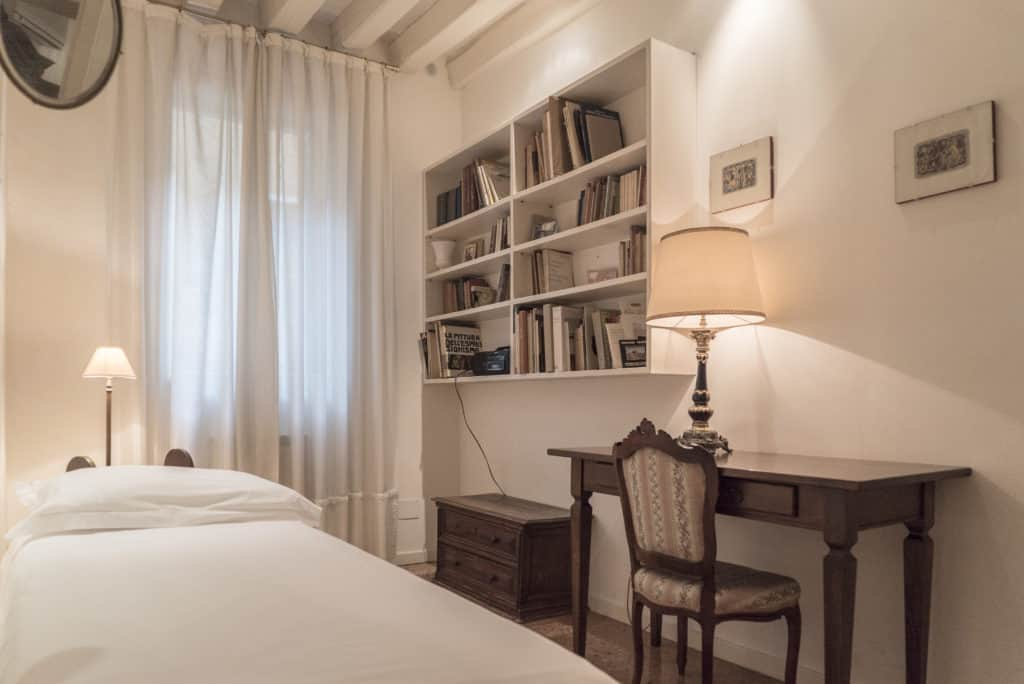 Right side of small bedroom with single bed and ancient desk - Accademia Terrazza Apartment