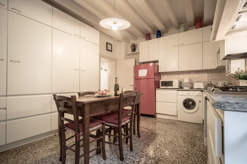 Left side of spacious kitchen with dining table - Accademia Terrazza Apartment
