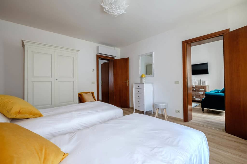 Left side of large twin bedroom - Ai Turchesi Apartment