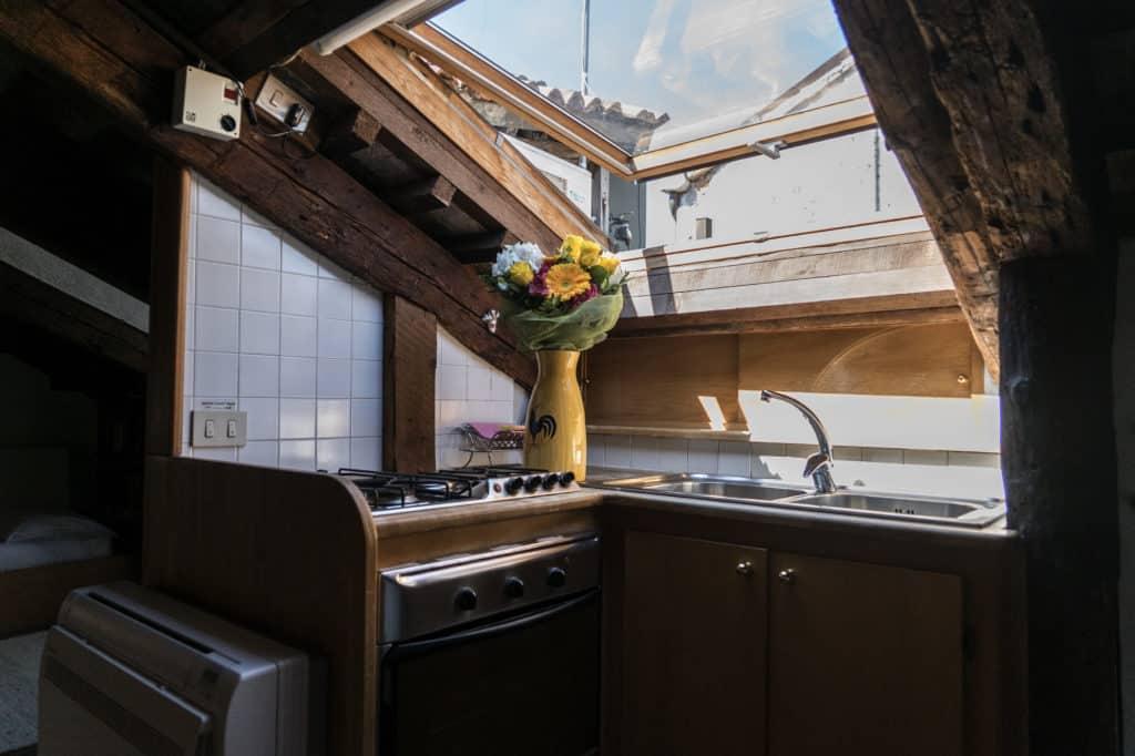 Small kitchen with luminous skylight window - Altana Studio Apartment