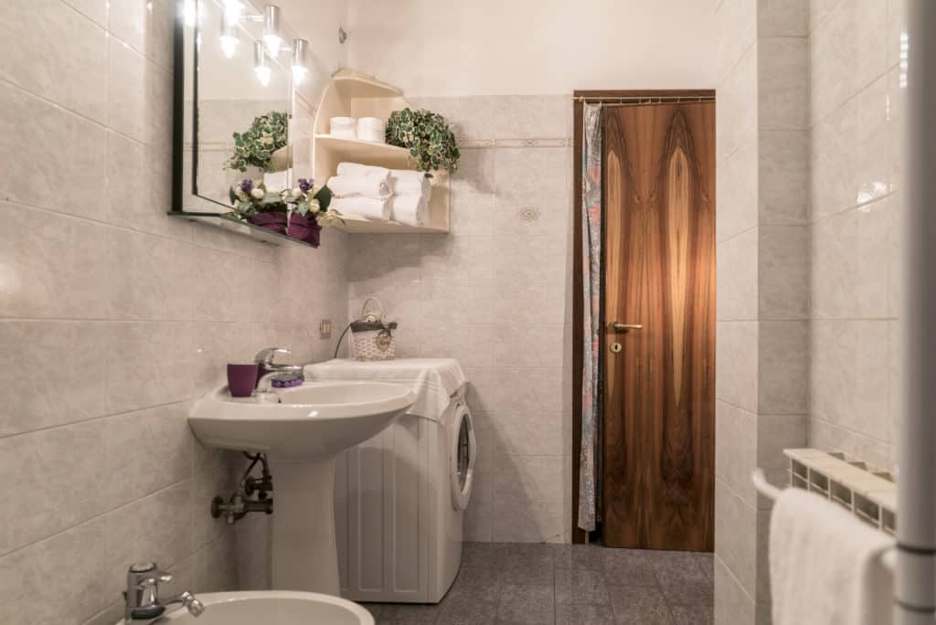 Entrance of the large bathroom with washing machine - Arsenal Flat Apartment
