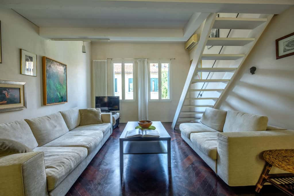 Large open space livingroom with stairs - Attico Terrace Apartment