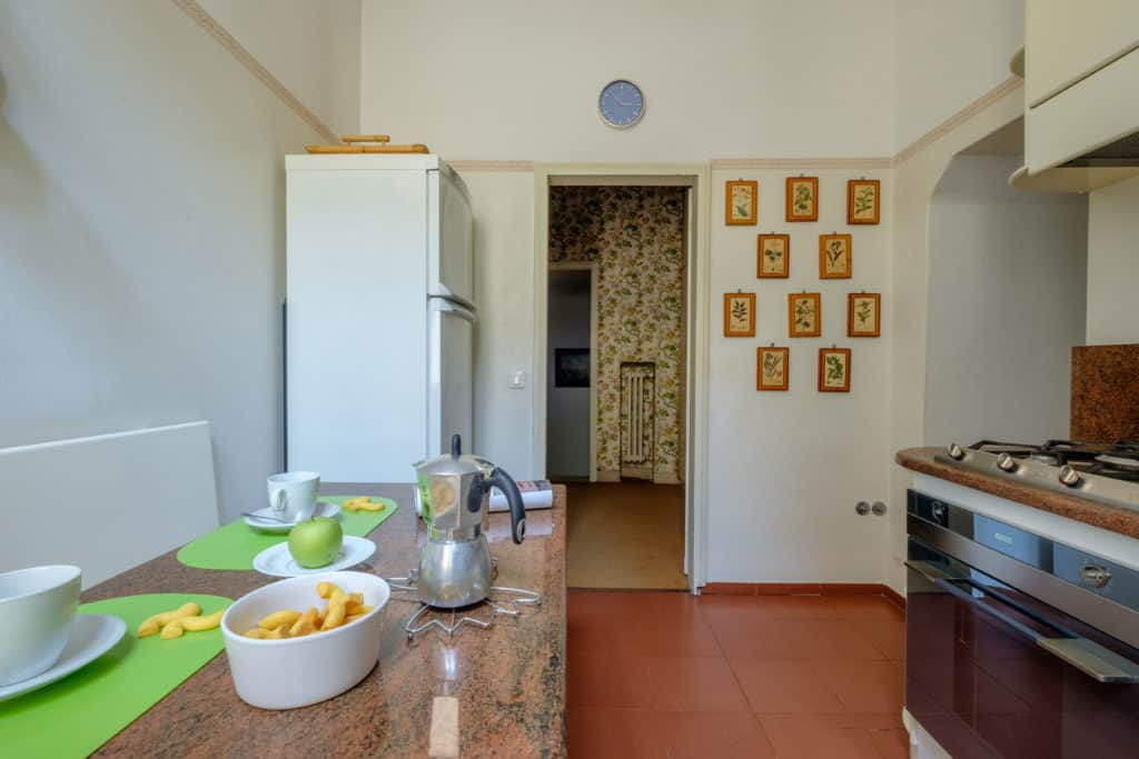 Entrance of the kitchen with fridge - Ca' Affresco 1 Apartment