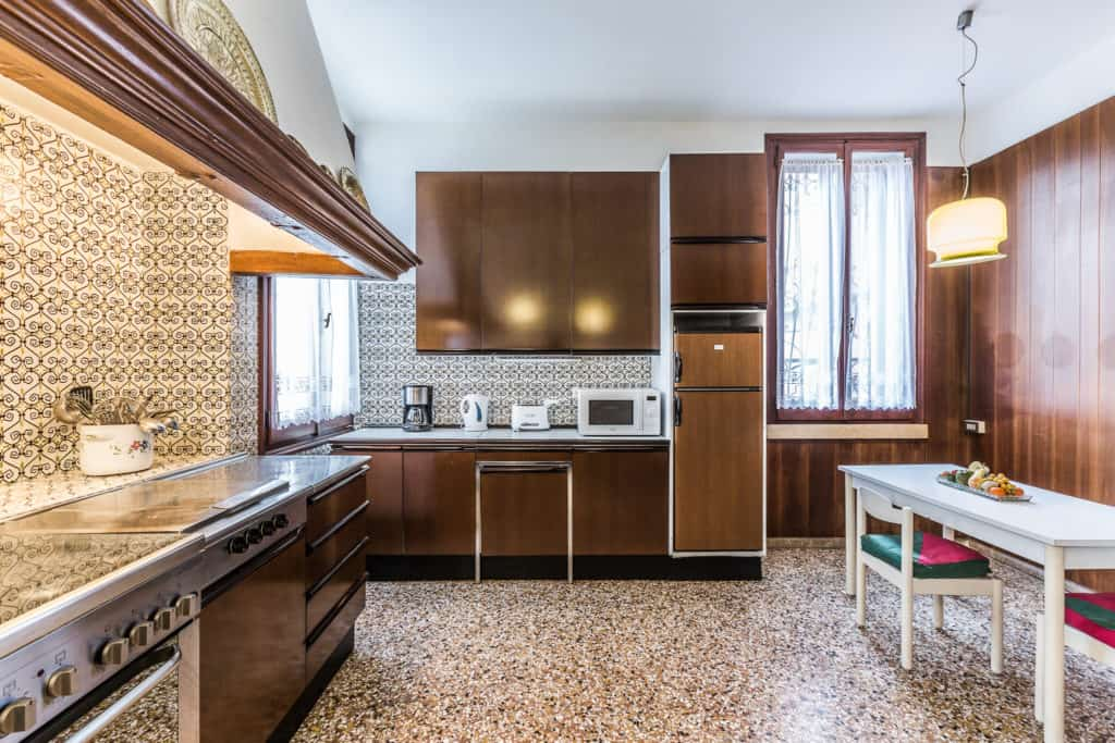 Right view of the large vintage styled kitchen with wooden walls  - Ca' Affresco 2 Apartment