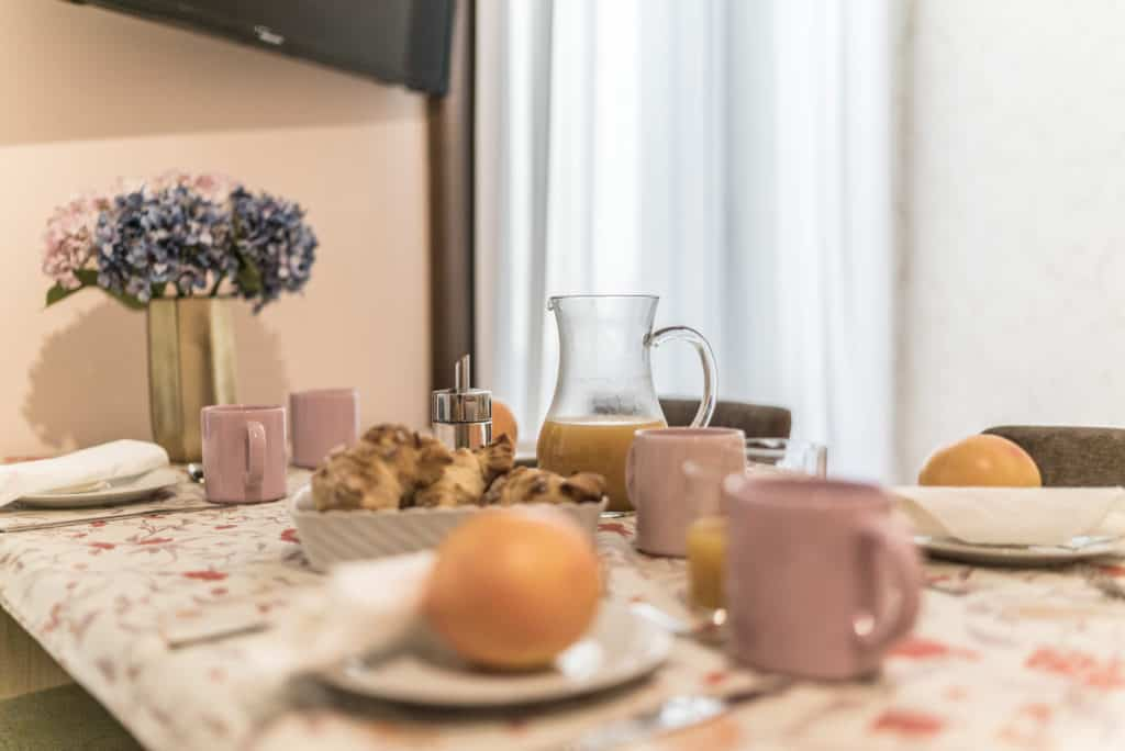 Dining table with breakfast - Ca' Desdemona Apartment