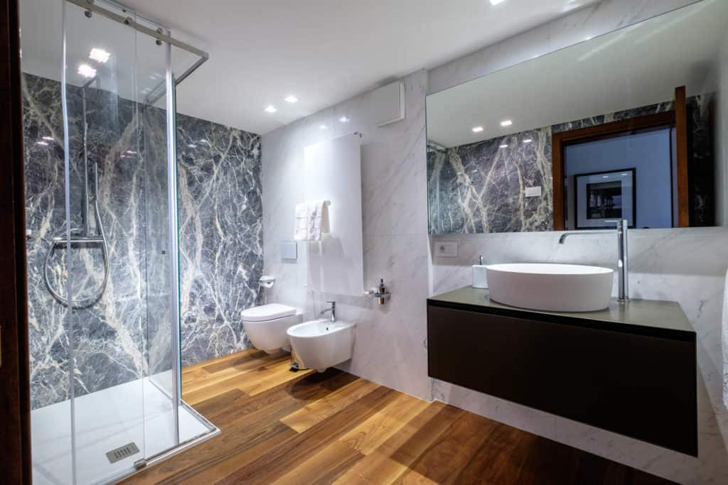 Entrance of the large marbled bathroom with shower - Ca' Garzoni Moro - Lido Apartment
