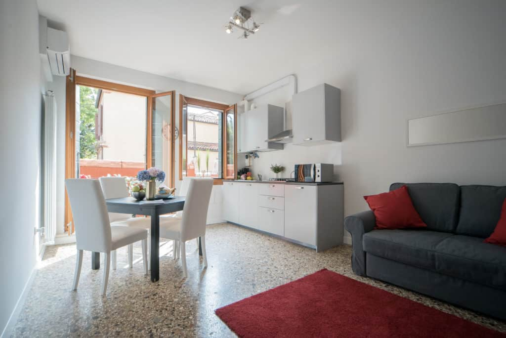 Big open air living, dining room and kitchen with sofa bed - Venier Apartment