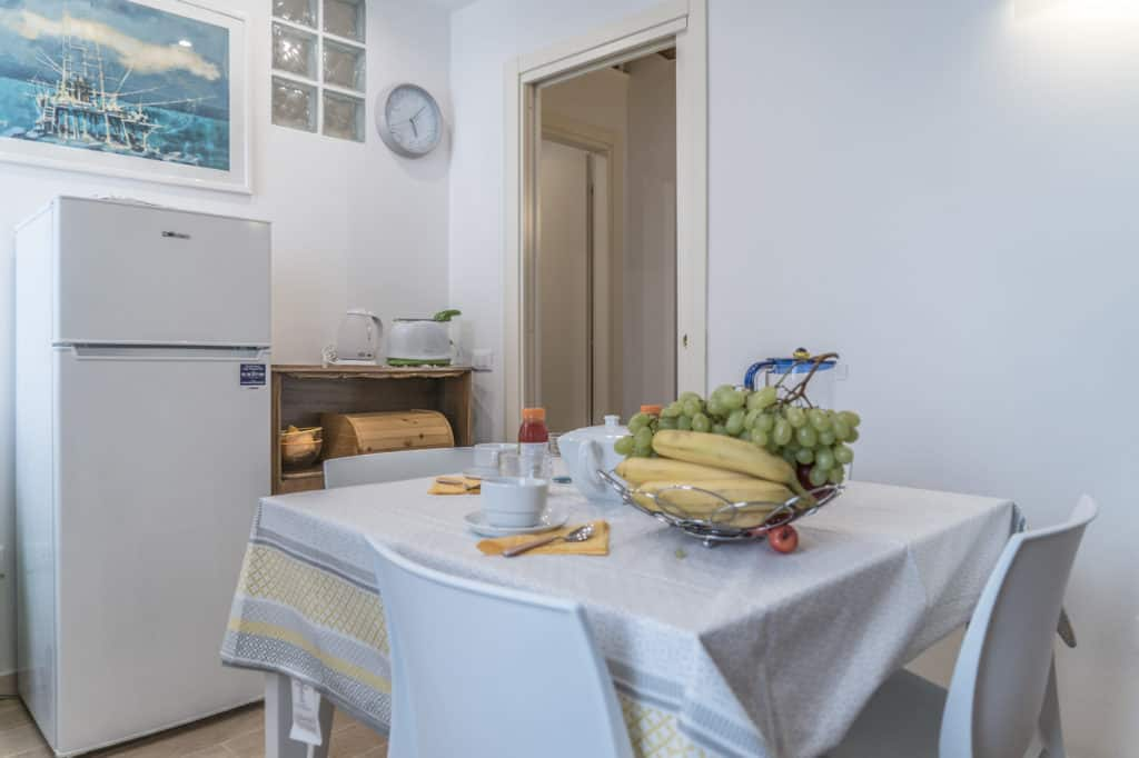 Entrance door of the small kitchen with fridge - Ca' Alba Apartment
