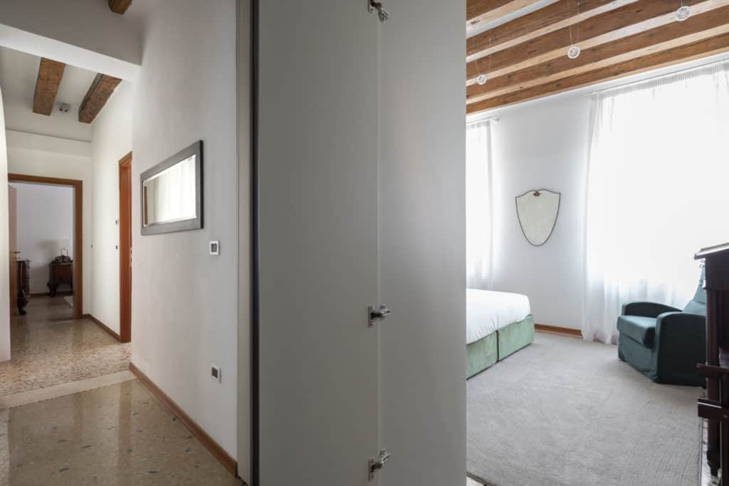 Hallway with bedroom door - Casa Graziosa Apartment