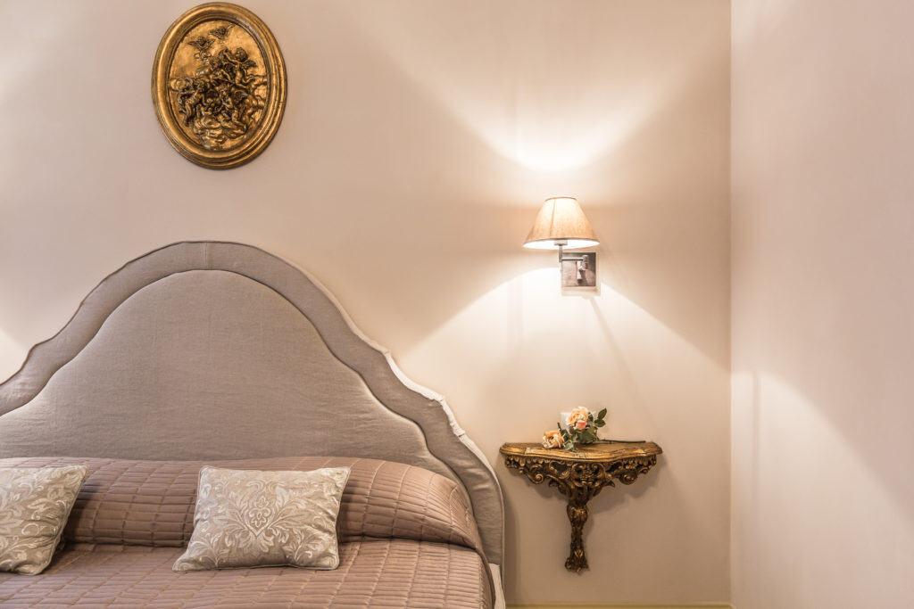 Detail of the large master bed - Palazzina Canal Apartment