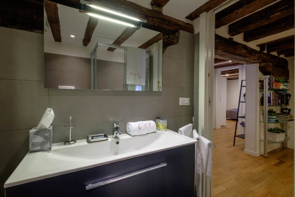 Entrance of the small bathroom with modern furnishing - The Lion's 5 Apartment