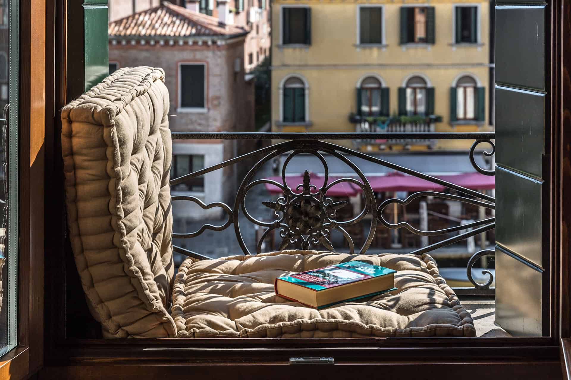 Typical Venetian balcony with a book and view on the campo - Rental Apartment in Venice